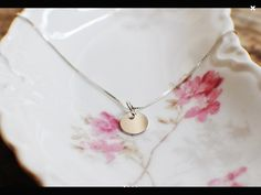 """This beautifully simple 100% sterling silver necklace is made using an 18"""" box chain and small round disc. Great for everyday wear or for layering with a longer or shorter necklace.   Shop this product here: http://spreesy.com/FancyChickDesigns/1   Shop all of our products at http://spreesy.com/FancyChickDesigns      Pinterest selling powered by Spreesy.com"""