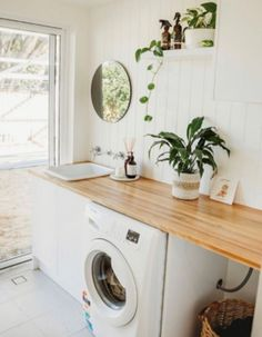 Laundry inspo! @perthrenovators' transformed their old laundry into this gorgeous and functional space using our gloss white doors in the modern profile.  . . . #kaboodle #kaboodlelaundry #bunningstimberbenchtop #laundrytransformation #laundryideas
