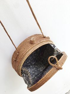 "**TAN PRE-ORDER DELIVERY FROM AUGUST 7th** Hand woven from Tenganan Village in Bali each basket is hand woven and ""smoked"" over coconut husks, adding patina and"