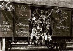 German soldiers in a railway goods wagon on the way to the front in 1914. Early in the war, all sides expected the conflict to be a short one.