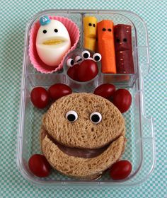 Goofy Faces Bento Box -- a few strategic cuts and some drawn-on eyes turn an egg, carrot sticks and a sandwich into an extra cute lunch. Fast and EASY!