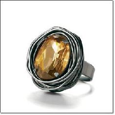"""mark. SOLID AS A ROCKAmber & Hematite RING  An amber-colored faux stone set in hematite metal. Adjustable, fits sizes 7-9. Measures 4/5"""" across.  Price:  $9.99 + FREE Shipping!  SHIMMER, BE MINE    Yardsellr gives you $5 photons to spend on your FIRS..."""