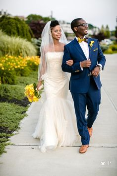 Tanzanian_Caribbean_wedding. i am officially in love with blue suits. I love how they blended it with yellow.