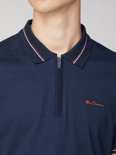 A classic polo shirt for men by Ben Sherman in navy blue, with striped tip detailing and a zip fastening polo shirt design for any occasion by Ben Sherman. Polo Shirt Style, Polo Shirt Outfits, Polo Shirt Design, Polo Design, Umgestaltete Shirts, Mens Polo T Shirts, Sports Shirts, Mens Tees, T Shirt Men