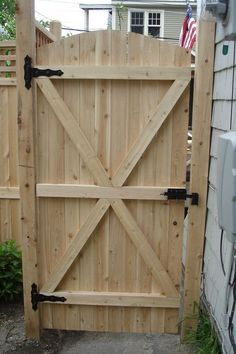 Charming Fence Gate Designs To Take Into Protect Your Home. Naturally Fence Gate Design Featuring Classic Solid Wood Fence Gate And Black Steel Fence Gate Hinges And Black Stainless Steel Door Lock. Building A Wooden Gate, Wooden Fence Gate, Fence Gate Design, Fence Doors, Fence Gates, Horse Fence, Bamboo Fence, Metal Fence, Picket Fence Gate