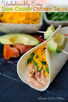 This crowd-pleasing Slow Cooker Chicken Tacos recipe is unbelievably easy to make and it's so delicious, it will quickly become a favorite family dinner. Clean Eating Recipes For Dinner, Vegetarian Recipes Dinner, Vegan Dessert Recipes, Easy Healthy Recipes, Sweets Recipes, Delicious Recipes, Dinner Recipes, Yummy Food, Slow Cooker Chicken Tacos