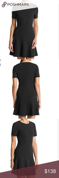 30% OFF BUNDLES - Ivanka Trump Scuba Shirt Dress Create a sleek style with this scuba knit dress from Ivanka Trump that features a hardware accent at the shoulder and a flared skirt. Featured in black Crew neck Short sleeves Hardware accent Seamed, flared skirt Polyester Imported Ivanka Trump Dresses