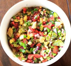 As my friends and family know, sometimes I go a little overboard when I proportion things out. It must be my Polish roots, but I'd rather have too much food for friends and family than not enough. Hence the MASSIVE amount of salsa this recipe made. Feel free to cut it in half, or if you want enough for a week, make the full amount. Its good with chips, on black bean burgers, in breakfast burritos, and on taco salads as well as many other things!