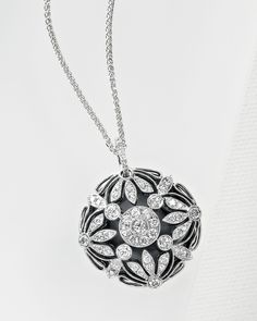 Floral diamond and onyx pendant necklace in 14kt white gold
