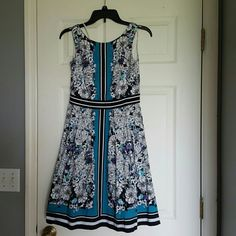 New york and company beautiful dress Floral but not overpoweringly. Bold blue. Perfect for summer for work and casual events. Worn once. In perfect condition New York & Company Dresses Asymmetrical