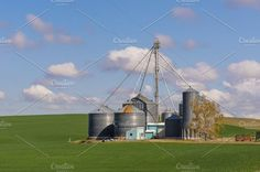 Check out Farm with grain storage silos by Zigzag Mountain Art on Creative Market Grain Storage, Grain Silo, Mountain Art, Business Photos, Elevator, Tractors, Fields, Grains, Planters