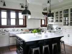 White subway tile is a classic choice that's equally at home in a modern, cottage, traditional or industrial kitchen. Its chameleon-like design qualities also make it a good candidate for extending beyond the traditional backsplash area into a whole wall application. Designer Rebekah Zaveloff took it a step further and used the timeless tile to also cover this kitchen's custom range hood so the fixture simply blends in.