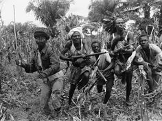 Baluba warriors in the central Congo province of Kasai train for battle with homemade small arms on January 2, 1961. According to Horst Faas, the photographer, he was not made welcome and the Balubas...