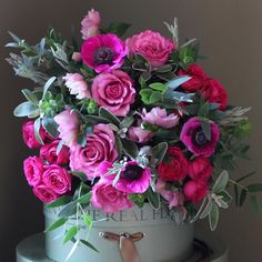 Exquisite scented garden hot pink roses mixed with hellebore's and Anemone's, hand tied with our garden herbs and foliage. http://www.realflowers.co.uk/the-real-flower-company-spring-rose-hellebore-anemone-bouquet.html