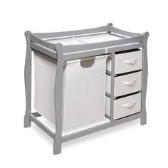 Features:  -Ample room for diaper changing on top with storage baskets and a hamper included below.  -Safety rails enclose all four sides of the changing area.  -Table can be wiped clean, hamper bag i