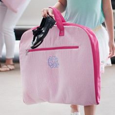 Great gift idea!!  Our classic seersucker garment bag is the perfect way to transport your favorite dress, formal gown, or hanging clothes. With multiple inside zipper pockets and a large outside zipper pocket there is plenty of room for extras. www.shoptickledpinkgifts.com