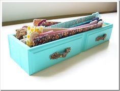Drawer display, Idea: fill with Spanish moss, fabric, lace, or wood covered with fabric to add height for small products - or fill with larger bottles of oils, waters, vigil candles, etc. Could also just have height lining the front with hole like slit for product to sit in & display while excess products sits below in rows behind displayed products