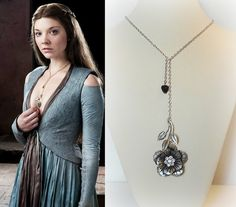 This pretty necklace is inspired by one worn by Natalie Dormer who plays Margaery Tyrell in Games of Thrones. It features:-  antique silver flower