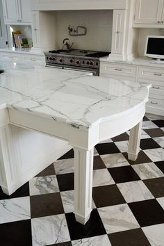 This statuary marble kitchen countertop was exquisitely crafted by Puma Marble. #luxeFL