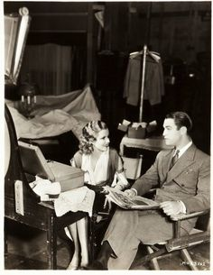 Jean Harlow and Chester Morris on the set of Red headed woman directed by Jack Conway, 1932