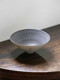Lucie Rie was one of the foremost potters of the 20th century. Though retaining conventional vase and bowl shapes, Rie created a highly expressive and original formal language, influenced by traditions ranging from prehistoric pots to Islamic fritware. Her technique was also innovative, notably for the practice of decorating and glazing pots before once-firing them.…
