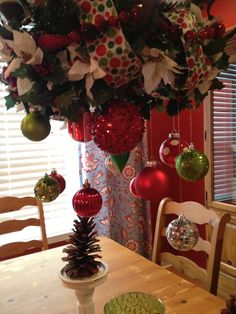 Christmas Ornament Chandelier with greenery, ribbon and deco mesh