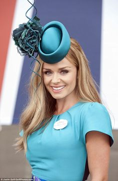 Ascot 2014 Ladies Day: Katherine Jenkins teamed her dress with a turquoise Philip Treacy headpiece 19th June 2014