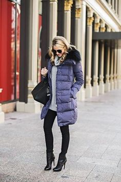 20 outfits that show puffer coats CAN be stylish - blue puffer coat with black fur trim and ankle boots