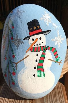 You'll receive the same one of it's kind Snowman Painted Rock seen in the pictures and video. This natural river stone is hand-painted on the front, while the back is left in it's natural state and signed by yours truly. Painted Rocks For Sale, Hand Painted Rocks, River Stones, Winter Theme, Custom Paint, Picture Video, Etsy Store, Snowman, Christmas