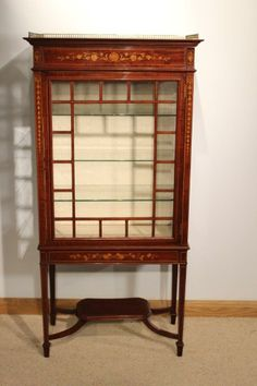 A Stunning quality Late Victorian mahogany inlaid antique display cabinet by Maple & Co