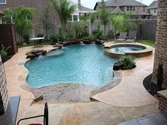 Natural Freeform Swimming Pool Design 235 — Custom Outdoors - Swimming Pools and more, servicing the Houston and Surrounding Areas including Katy, Sugarland, Pearland, Richmond, Rosenberg, Cypress, Tomball, Spring, and The Woodlands
