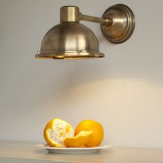 Our Derby #spot #light in #Antique #Brass is the perfect task light over kitchen work surfaces.