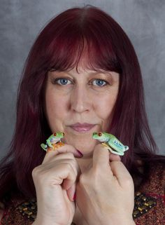 Photographer Angi Nelson with two of her frogs