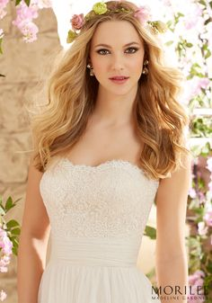 A Soft Whimsical and Ethereal feel for Morilee by Madeline Gardner A-Line Flowy Wedding Dress style 6801. Romantic and Bohemian, this bridal gown has an Alencon lace Strapless Bodice onto Soft Net Skirt.