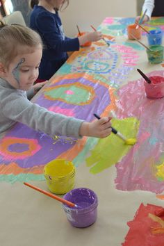 All you need is a roll of paper and some washable paint for this collaborative mural with kids!
