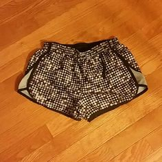 Under Armour Running Shorts- XS Size Extra Small Under Armour Running Shorts! Purple, Gray, and black polka dots! Too cute! Lined with black! Under Armour Shorts