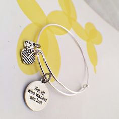 Not all who wander bangle Silver bangle with a great quote. Brand new and adjustable. One size fits most. JBJ Jewelry Bracelets