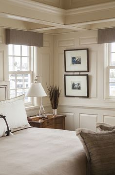 Benjamin Moore Navajo White.  Nice room, especially the paneling and ceiling....good it is in white and has a couple of windows otherwise it would be oppressive.