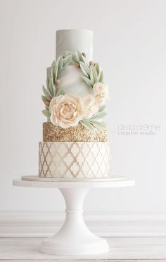 Drop-dead gorgeous mint, white and gold wedding cake with intricate design details; Featured Cake: De la Creme Studio