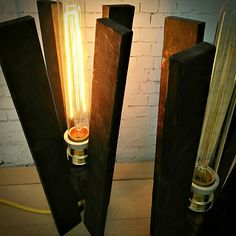 Customizing a wood lamp, burnt wood, edison bulb and yellow textile cable.