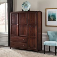 FREE SHIPPING Attractive metal knobs, a rich finish, and elegant Shaker style: this luxurious-looking Armoire has what it takes to give your bedroom that refined touch. Its modernized traditional styl