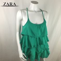 """Zara Trafaluc Sleeveless Ruffle Blouse Super cute Zara Trafaluc blouse! Has a layered ruffle and racerback design. In great condition, 14"""" across the chest and 27"""" long   Save 20% Off Bundles!   Sorry, No Trades!   Thanks For Stopping By!  Zara Tops Blouses"""