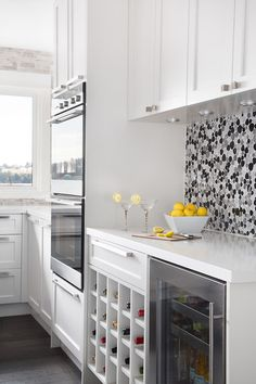 Fabulous Under Cabinet Lighting Design In Contemporary Kitchen With White Cabinets Made From Wooden Material With Silver Handle Made From Metallic Material on We Heart It