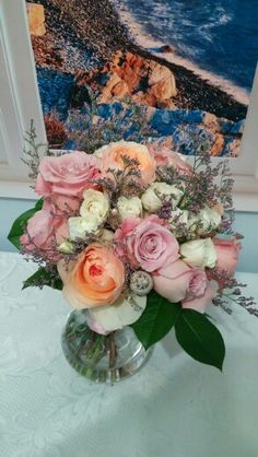 Faith pink roses and Juliet peach garden roses. White spray rosrs with various beads and misty blue for lavender accents.