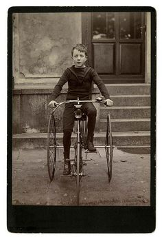 [Young boy on tricycle]