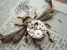 Hey, I found this really awesome Etsy listing at http://www.etsy.com/listing/74010800/steampunk-necklace-rustic-brass-bee
