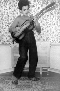 George Harrison (1943-2001), with his first guitar, an Egmond acoustic, in 1956.