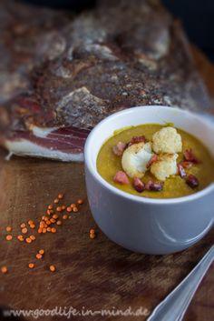 Rote Linsen in Suppe mit Blumenkohl und Tiroler Schinken