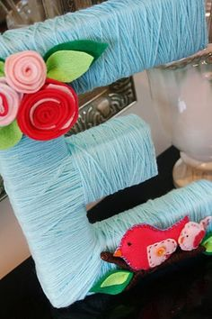 Tutorial: Yarn-Wrapped Letter by And Everything Sweet via double the fun parties blog.  Cute idea for baby room