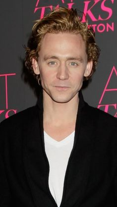 Hiddles. Can't decide if he's blond or ginger here,but guessing ginger...